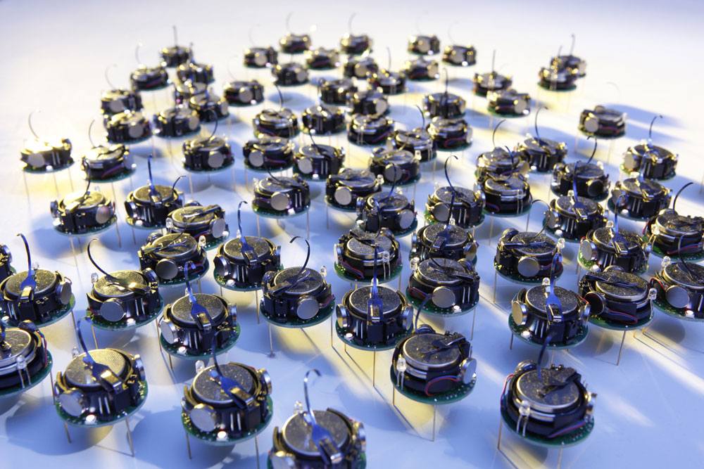 Swarms of tiny robots can communicate less with better decisions